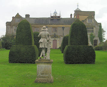 The Statue complements the topiary