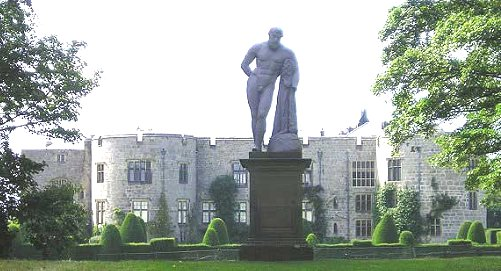 Statue set off by walled hedges