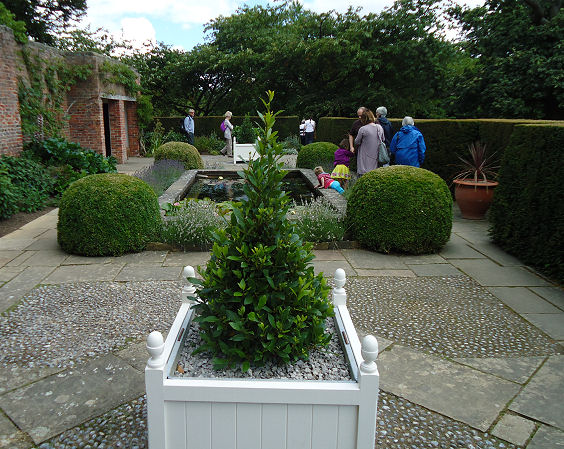 It's twin garden with Versailles planter