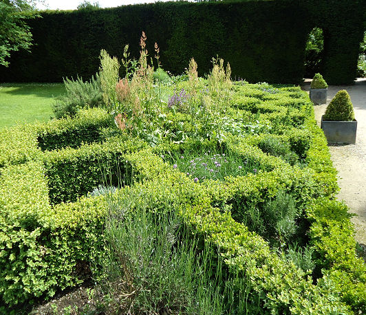High parterre inter planted with herbs at the main entrance to the gardens