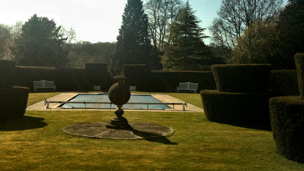 he yew topiary surrounding a swimming pool!