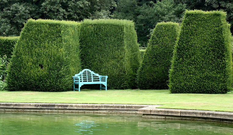 Topiary complemented by a blue Lutyens bench
