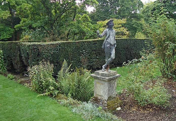 Historical statuary accentuates the feeling of splendour in the yew walks.