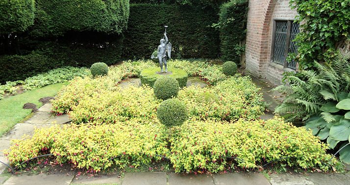 Box topiary balls near the base of the tower