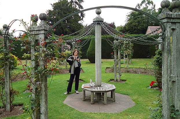 Central rose arbour surrounded by yew hedges