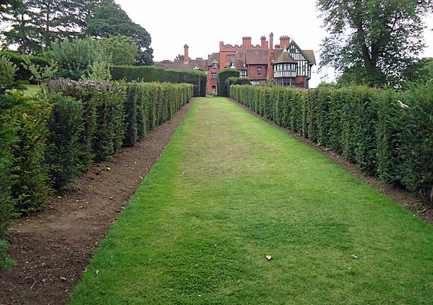 Yew hedge lined avenue giving great vista of the house