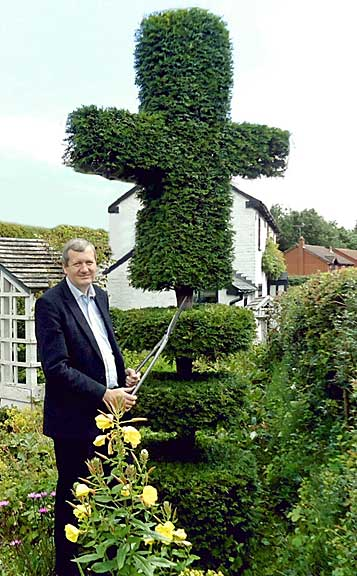 Anthony Blagg and his topiary cross